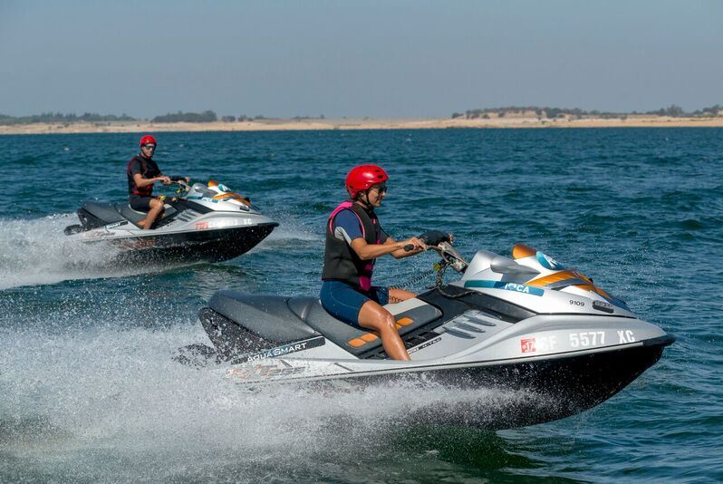 people on jet skis wearing safety gear